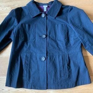 Navy blue jacket with slight peplum and buttons